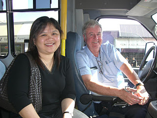 bus driver and woman passenger