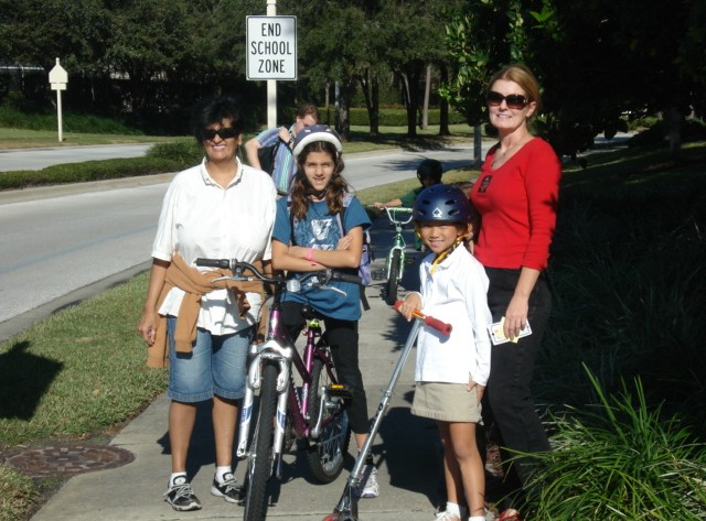 Moms and kids biking
